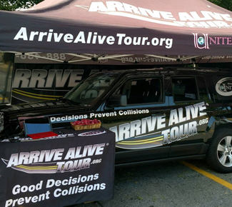 Vehicle under a tent highlighting the Arrive Alive Tour